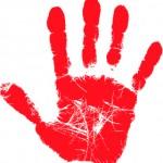 Empreinte rouge d'une main ouverte